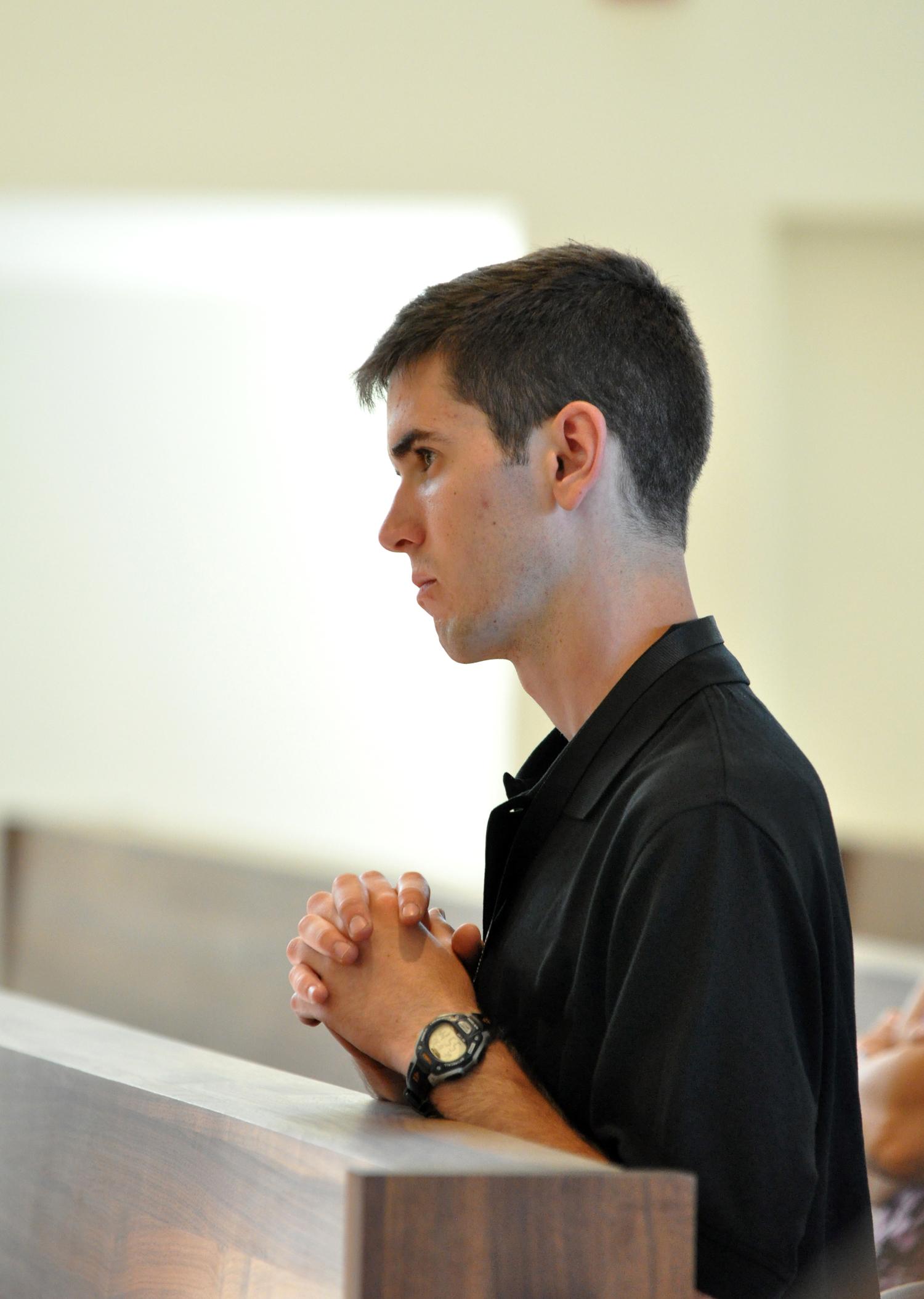 young-man-praying-from-Bridgeport